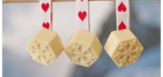 Festive white chocolates on ribbon