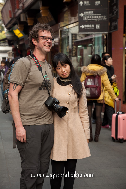 Chris posing for a photo with a Chinese tourist!