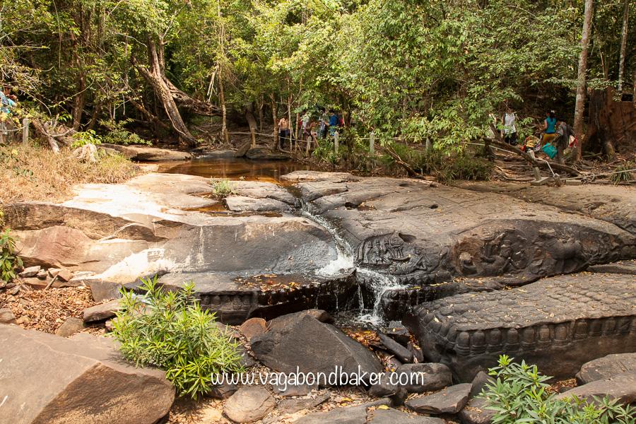 Hindu deities carved on the waterfall.