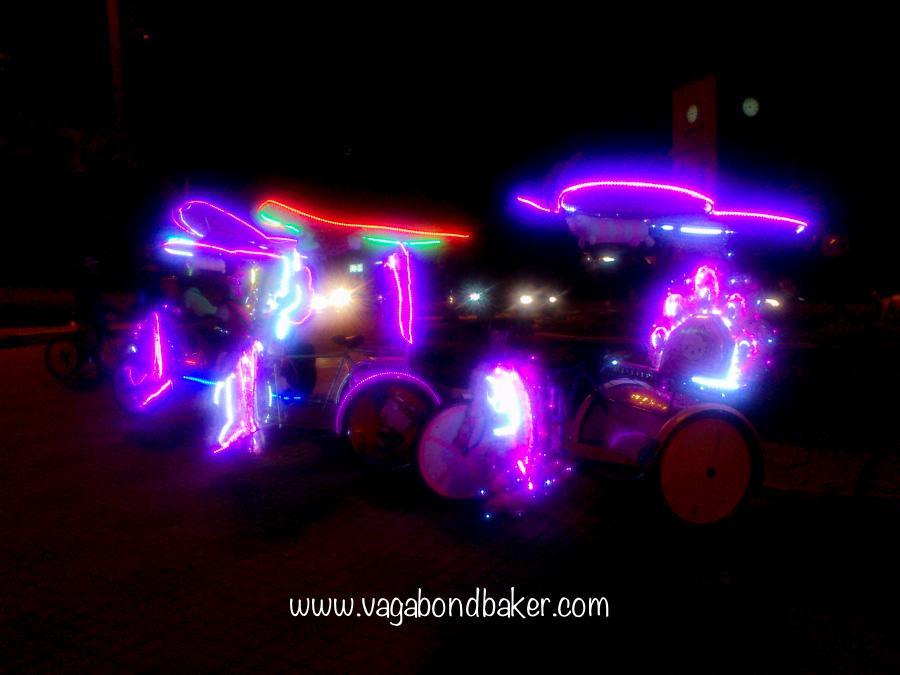 Trishaws at night!